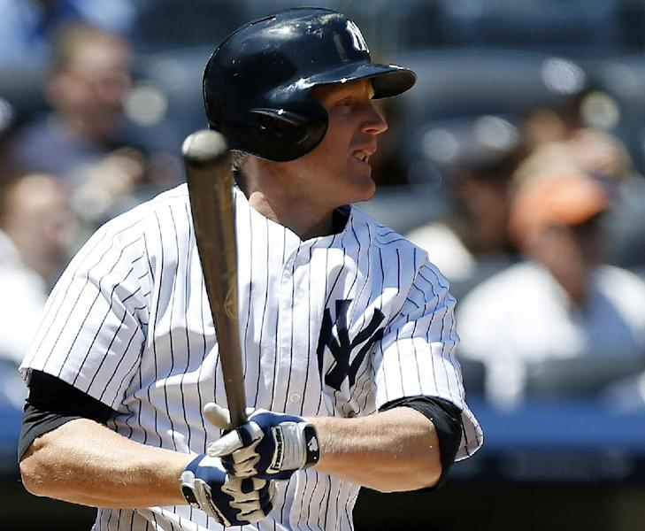 New York Yankees' Lyle Overbay hits a two-run double against the Los Angeles Dodgers during the second inning of a baseball game Wednesday, June 19, 2013, in New York. (AP Photo/Kathy Willens)