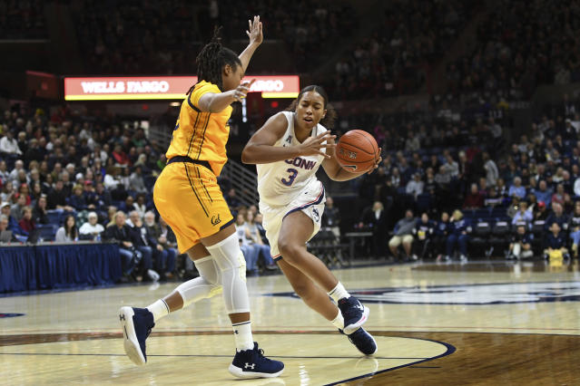 Connecticut's Megan Walker (3) drives around California's Jaelyn Brown (33) in the first half of a women's NCAA college basketball game, Sunday, Nov. 10, 2019, in Storrs, Conn. (AP Photo/Stephen Dunn)