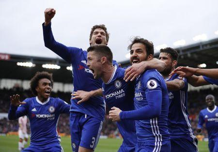 Britain Football Soccer - Stoke City v Chelsea - Premier League - bet365 Stadium - 18/3/17 Chelsea's Gary Cahill celebrates scoring their second goal with teammates Reuters / Phil Noble Livepic