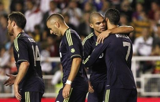 Real Madrid's Cristiano Ronaldo from Portugal, right, cerebrates his goal with teammates during a Spanish La Liga soccer match against Rayo Vallecano at the Vallecas stadium in Madrid, Spain, Monday, Sept. 24, 2012. (AP Photo/Andres Kudacki)
