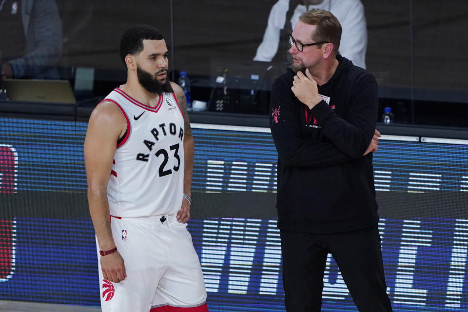 Toronto Raptors' head coach Nick Nurse, right, speaks with Fred VanVleet during the second half of an NBA basketball game against the Los Angeles Lakers, Saturday, Aug. 1, 2020, in Lake Buena Vista, Fla. (AP Photo/Ashley Landis, Pool)