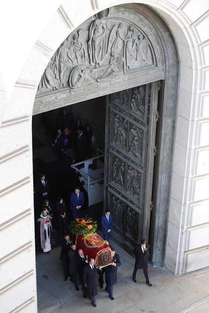 Relatives carry the coffin with the remains of Spanish dictator General Francisco Franco at the Valley of the Fallen mausoleum near El Escorial, outskirts of Madrid, Spain, Thursday, Oct. 24, 2019. Spain is exhuming the remains of Spanish dictator Gen. Francisco Franco from his grandiose mausoleum outside Madrid so he can be reburied in a small family crypt north of the capital. (AP Photo/Emilio Naranjo, Pool)