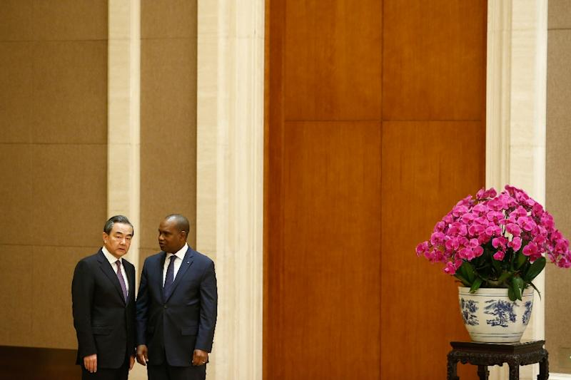 Chinese Foreign Minister Wang Yi (L with Alpha Barry) said Burkina Faso had 'made the right political decision' (AFP Photo/THOMAS PETER)