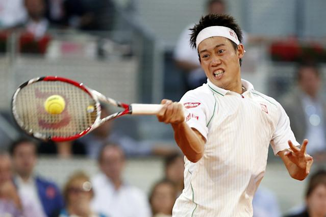 Kei Nishikori from Japan returns the ball during a Madrid Open tennis tournament match against David Ferrer from Spain in Madrid, Spain, Saturday, May 10, 2014. (AP Photo/Andres Kudacki)
