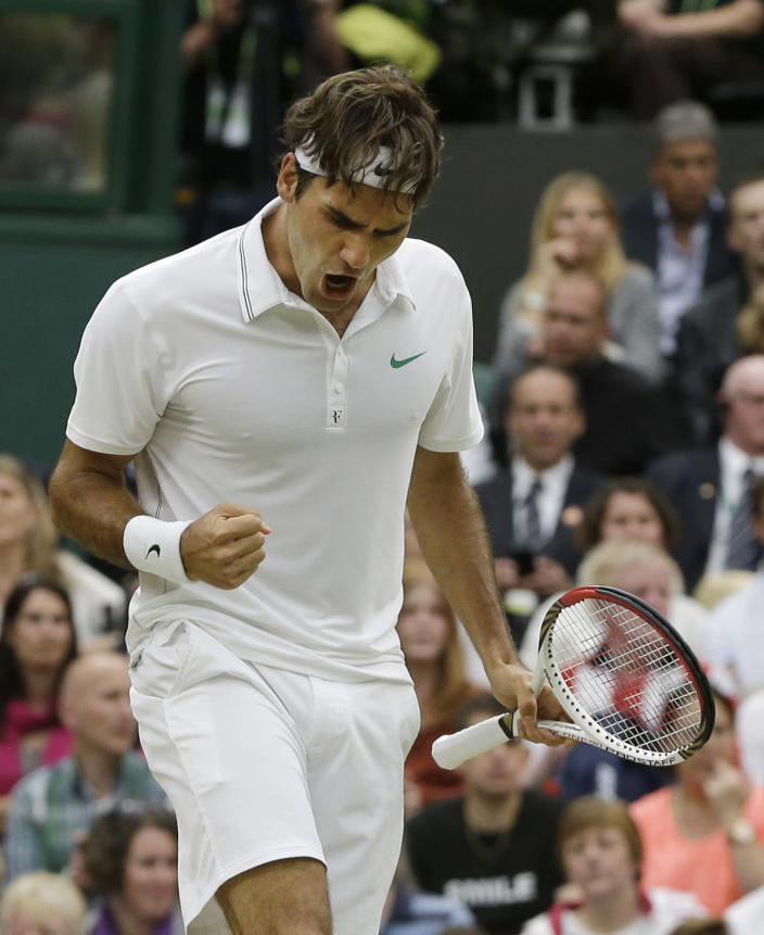 Roger Federer of Switzerland reacts during the men's final match against Andy Murray of Britain at the All England Lawn Tennis Championships at Wimbledon, England, Sunday, July 8, 2012. (AP Photo/Kirsty Wigglesworth)