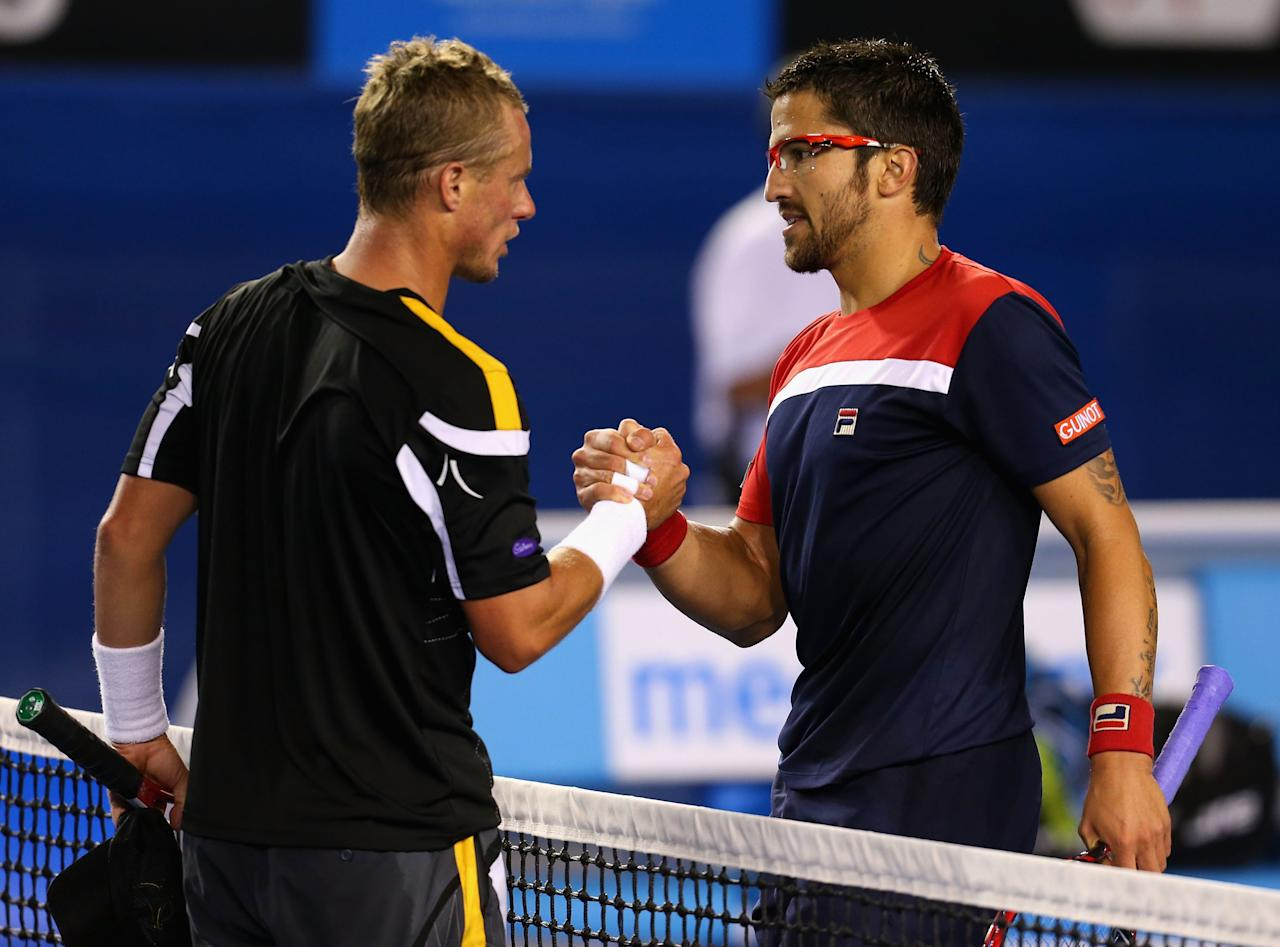MELBOURNE, AUSTRALIA - JANUARY 14: Lleyton Hewitt of Australia congratulates Janko Tipsarevic of Serbia on winning their first round match against  during day one of the 2013 Australian Open at Melbourne Park on January 14, 2013 in Melbourne, Australia.  (Photo by Scott Barbour/Getty Images)