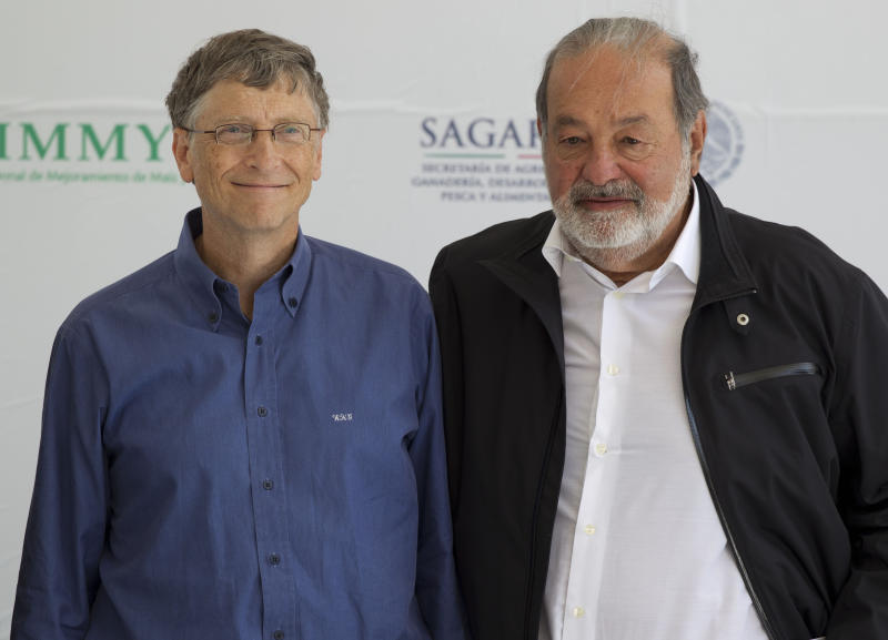 Microsoft Chairman Bill Gates, left, and Mexican telecommunications tycoon Carlos Slim poses for photographers during the inauguration of the new research center at the International Center for Improvement of Corn and Wheat (CIMMYT) in Texcoco, Mexico, Wednesday, Feb. 13, 2013. Gates and Slim teamed up to to fund new seed breeding research which the CIMMYT says aims to sustainably increase the productivity of maize and wheat systems to ensure global food security and reduce poverty. (AP Photo/Eduardo Verdugo)