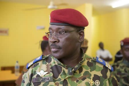 Lieutenant Colonel Isaac Zida attends a news conference in which he was named president at the military headquarters in Ouagadougou