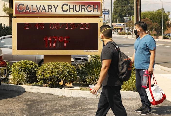 "The thermometer at Calvary Church in Woodland Hills registers 117 degrees during a heat wave last month. <span class=""copyright"">(Al Seib / Los Angeles Times)</span>"