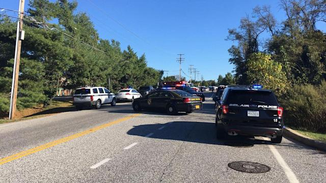 <p>Police cars block off Edgewood Road near the entrance to Emmorton Business Park where the Harford County Sheriff's office says multiple people were shot Wednesday morning. (Photo: Ted Hendricks/The Aegis/BSMG) </p>
