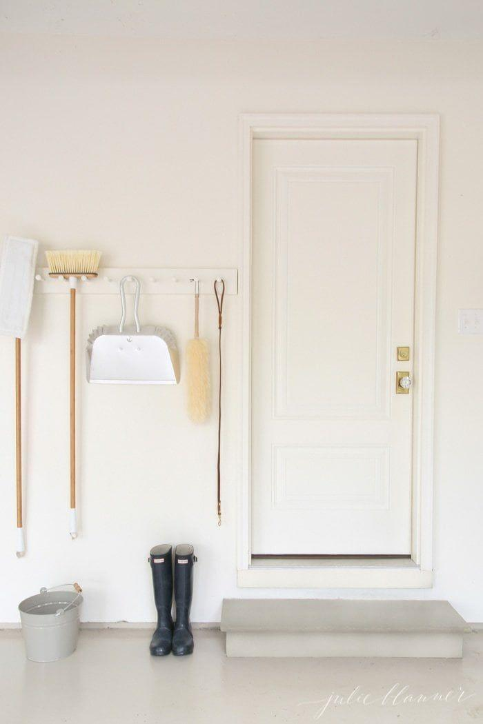 """<p>One of the simplest way to store items in the garage is with a peg rail. Hang coats, cleaning goods, pet items—whatever your heart desires—from it and get your space on the way to shipshape.</p><p><strong>Get the tutorial at <a href=""""https://julieblanner.com/garage-organization/"""" rel=""""nofollow noopener"""" target=""""_blank"""" data-ylk=""""slk:Julie Blanner"""" class=""""link rapid-noclick-resp"""">Julie Blanner</a>.</strong></p><p><a class=""""link rapid-noclick-resp"""" href=""""https://www.amazon.com/InterDesign-Leashes-Jackets-Bedroom-Entryway/dp/B000H5OWIO/ref=sr_1_2?tag=syn-yahoo-20&ascsubtag=%5Bartid%7C10050.g.36449426%5Bsrc%7Cyahoo-us"""" rel=""""nofollow noopener"""" target=""""_blank"""" data-ylk=""""slk:SHOP PEG RAILS"""">SHOP PEG RAILS</a><br></p>"""