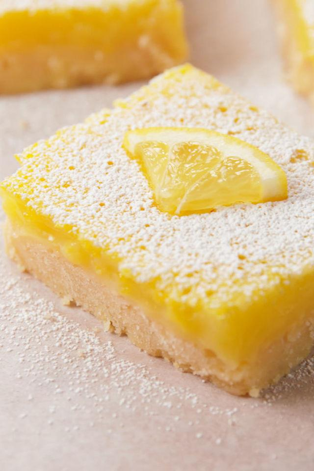 "<p>Pucker up—these babies are sweet.</p><p>Get the recipe from <a rel=""nofollow"" href=""http://www.delish.com/cooking/recipes/a52125/easy-lemon-bars-recipe/"">Delish</a>.</p>"