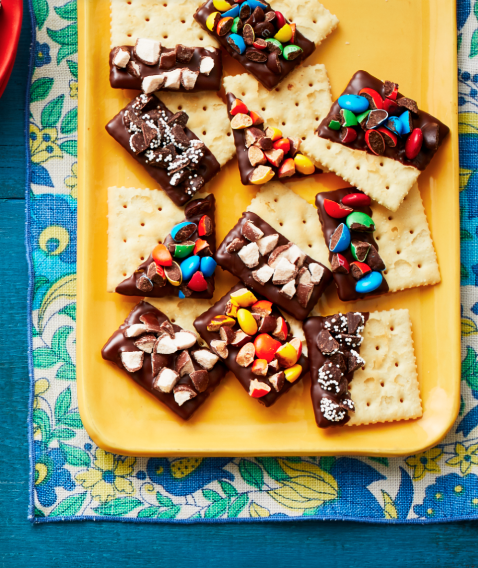 """<p>These sweet-and-salty treats will be a hit at this year's Halloween party, plus they're an equally fun way to use up leftover candy. </p><p><strong><a href=""""https://thepioneerwoman.com/food-cooking/recipes/a32129917/concession-stand-crackers-recipe/"""" rel=""""nofollow noopener"""" target=""""_blank"""" data-ylk=""""slk:Get the recipe."""" class=""""link rapid-noclick-resp"""">Get the recipe.</a></strong> </p><p><a class=""""link rapid-noclick-resp"""" href=""""https://go.redirectingat.com?id=74968X1596630&url=https%3A%2F%2Fwww.walmart.com%2Fip%2FThe-Pioneer-Woman-Spring-10-Piece-Baking-Prep-Set-Teal%2F269954471&sref=https%3A%2F%2Fwww.thepioneerwoman.com%2Ffood-cooking%2Fmeals-menus%2Fg32110899%2Fbest-halloween-desserts%2F"""" rel=""""nofollow noopener"""" target=""""_blank"""" data-ylk=""""slk:SHOP BAKING TOOLS"""">SHOP BAKING TOOLS</a></p>"""