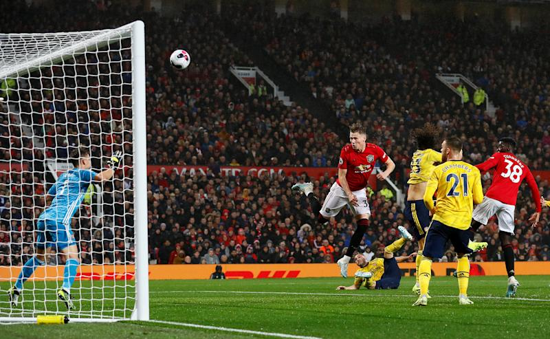 """Soccer Football - Premier League - Manchester United v Arsenal - Old Trafford, Manchester, Britain - September 30, 2019 Manchester United's Scott McTominay heads the ball at goal REUTERS/Andrew Yates EDITORIAL USE ONLY. No use with unauthorized audio, video, data, fixture lists, club/league logos or """"live"""" services. Online in-match use limited to 75 images, no video emulation. No use in betting, games or single club/league/player publications. Please contact your account representative for further details."""