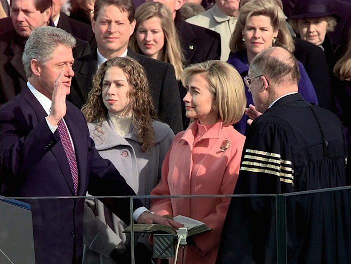 <p>Supreme Court Chief Justice William Rehnquist administers the presidential oath to President Clinton as first lady Hillary Rodham Clinton and daughter Chelsea look on, Monday Jan. 20, 1997 on Capitol Hill in Washington. (Photo: Doug Mills/AP)</p>
