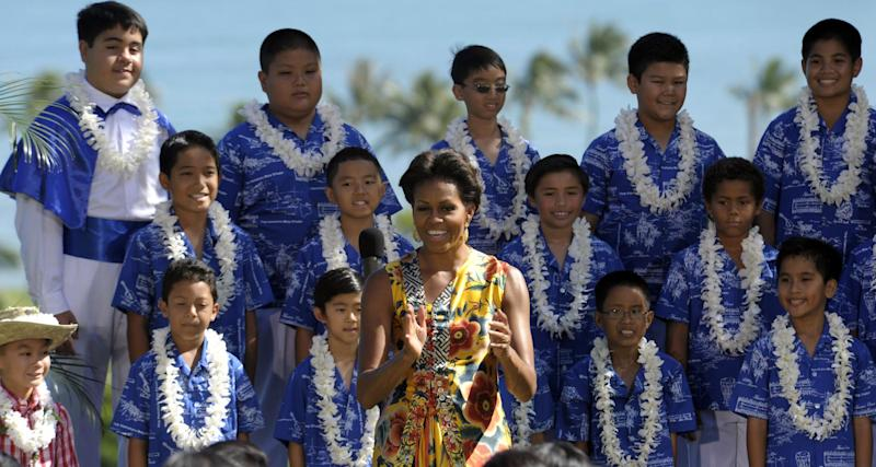 First lady Michelle Obama speaks after watching a performance by the Honolulu Boys Choir at the APEC Spousal Luncheon at Kualoa Ranch in Ka'a'awa, Hawaii, Sunday, Nov. 13, 2011.  (AP Photo/Susan Walsh)