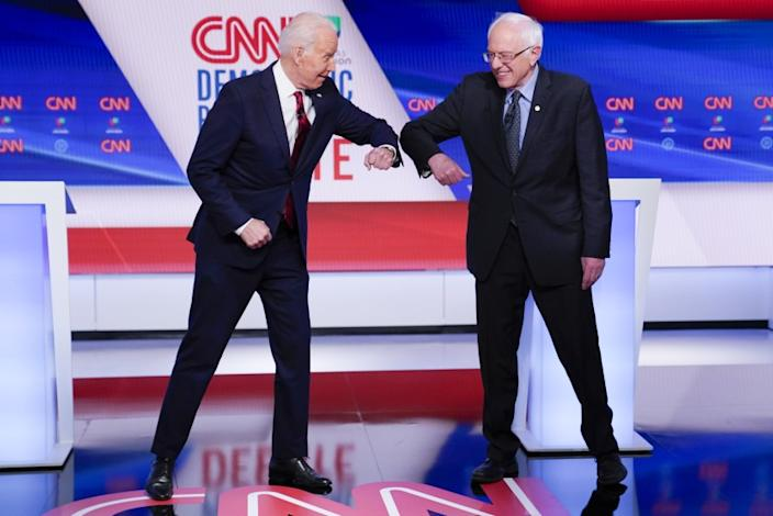 "Joe Biden and Bernie Sanders greet each other before their March 15 Democratic presidential primary debate in Washington. <span class=""copyright"">(Evan Vucci / Associated Press)</span>"