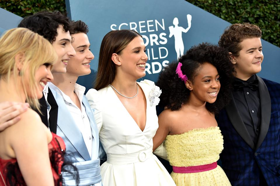 LOS ANGELES, CALIFORNIA - JANUARY 19:(L-R) Cara Buono, Finn Wolfhard, Noah Schnapp, Millie Bobby Brown, Priah Ferguson, and Gaten Matarazzo attends the 26th Annual Screen Actors Guild Awards at The Shrine Auditorium on January 19, 2020 in Los Angeles, California. (Photo by Jeff Kravitz/FilmMagic)