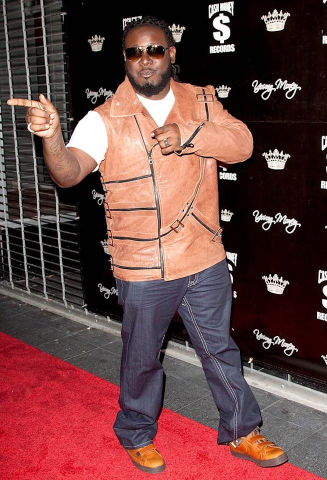 "Despite being recently panned by critics for his remake of the 1983 Michael Jackson classic ""P.Y.T."" at Quincy Jones' request, T-Pain strutted his stuff in a one-sleeved leather jacket. The rapper defended himself on Twitter: ""For all the people that hate me for ruining PYT, just stop listening to my s---. But if Quincy Jones tell you he want you to do something, no matter how much s--- you know you're gonna get from the dumb a---- in the world, you do it. The f----- up thing is everybody being so kind to MJ after he's gone, but how can you wish a man to rest in peace when you never gave him peace in a life time? I had the pleasure of meeting MJ and when I left his house I got a call from his lawyer telling me that MJ wanted me to remake that song."" John Parra/<a href=""http://www.wireimage.com"" target=""new"">WireImage.com</a> - November 7, 2010"