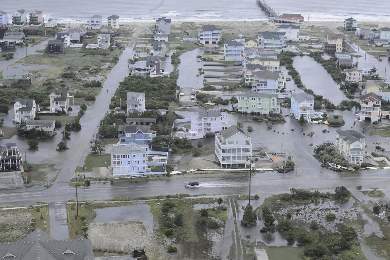 Flooding from Hurricane Arthur is pictured on the Outer Banks of North Carolina in this July 4, 2014 aerial handout photo provided by the U.S. Coast Guard. Arthur hit the North Carolina coast early on Friday and then weakened as it moved out to sea, causing no deaths or injuries but spoiling the Independence Day holiday for thousands of Americans. The first hurricane of the Atlantic season struck land at the southern end of North Carolina's Outer Banks at 11:15 p.m. on Thursday (0315 GMT Friday). It rattled vacation homes, flooded roads and cut off island communities from the mainland. REUTERS/U.S. Coast Guard/Handout via Reuters (UNITED STATES - Tags: ENVIRONMENT DISASTER) ATTENTION EDITORS - THIS PICTURE WAS PROVIDED BY A THIRD PARTY. REUTERS IS UNABLE TO INDEPENDENTLY VERIFY THE AUTHENTICITY, CONTENT, LOCATION OR DATE OF THIS IMAGE. FOR EDITORIAL USE ONLY. NOT FOR SALE FOR MARKETING OR ADVERTISING CAMPAIGNS. THIS IMAGE HAS BEEN SUPPLIED BY A THIRD PARTY. IT IS DISTRIBUTED, EXACTLY AS RECEIVED BY REUTERS, AS A SERVICE TO CLIENTS