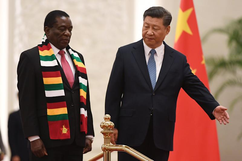 Zimbabwe's President Emmerson Mnangagwa (L) stands with Chinese President Xi Jinping during a welcoming ceremony at the Great Hall of the People in Beijing on April 3, 2018. Mnangagwa is on a visit to China to seek economic support from a major partner that previously backed his ousted predecessor Robert Mugabe. / AFP PHOTO / GREG BAKER (Photo credit should read GREG BAKER/AFP/Getty Images)