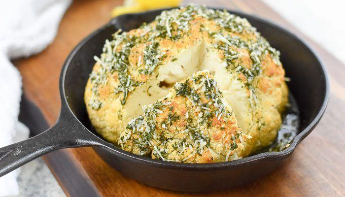 """<p>If you've never made whole roasted cauliflower before, give this recipe a try! This version is flavored with herbs, parmesan and plenty of olive oil for maximum flavor. </p><p><strong>Get the recipe at <a href=""""https://www.dashofjazz.com/lemon-alfredo-whole-roasted-cauliflower/"""" rel=""""nofollow noopener"""" target=""""_blank"""" data-ylk=""""slk:Dash of Jazz."""" class=""""link rapid-noclick-resp"""">Dash of Jazz.</a></strong></p><p><a class=""""link rapid-noclick-resp"""" href=""""https://go.redirectingat.com?id=74968X1596630&url=https%3A%2F%2Fwww.walmart.com%2Fsearch%2F%3Fquery%3Dpioneer%2Bwoman%2Bcookware&sref=https%3A%2F%2Fwww.thepioneerwoman.com%2Ffood-cooking%2Fmeals-menus%2Fg35514088%2Fbest-side-dishes-for-ham%2F"""" rel=""""nofollow noopener"""" target=""""_blank"""" data-ylk=""""slk:SHOP COOKWARE"""">SHOP COOKWARE</a></p>"""
