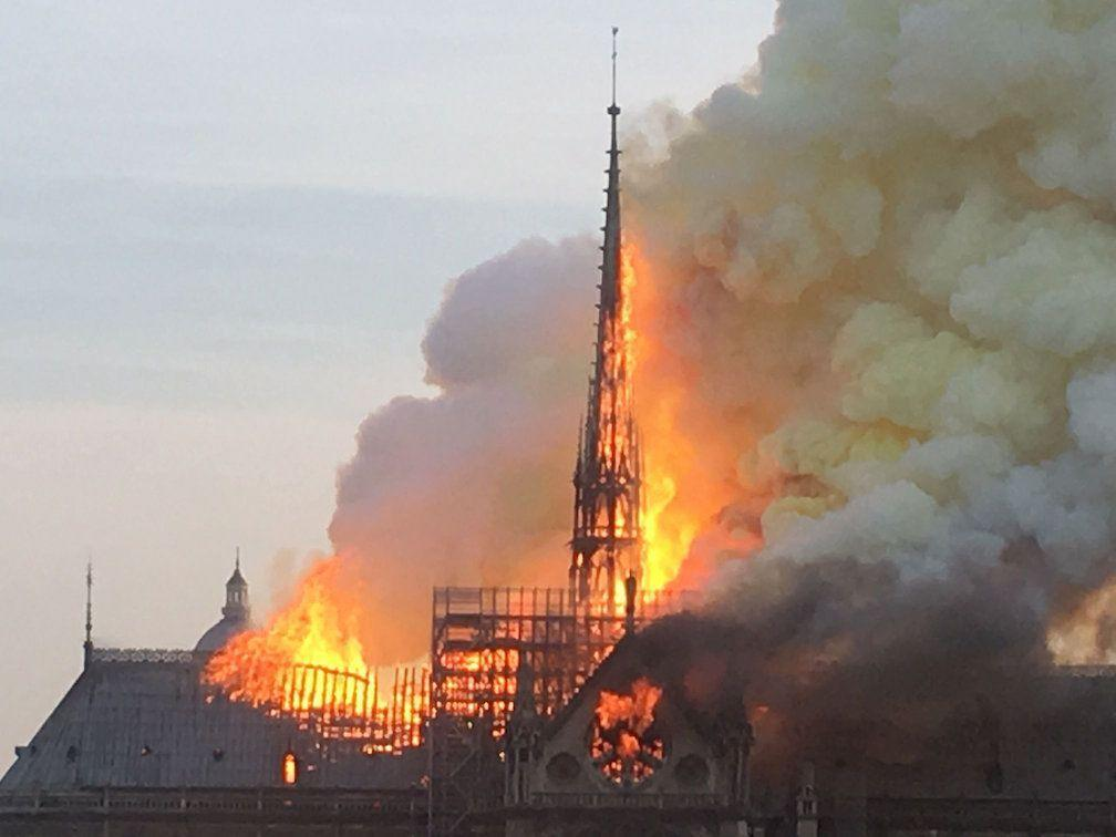 The spire at Notre Dame burns before collapsing (Picture: PA)