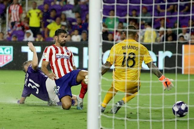 Diego Costa, center, of Atletico Madrid scores a goal against the MLS All-Stars on Wednesday (AFP Photo/SAM GREENWOOD)