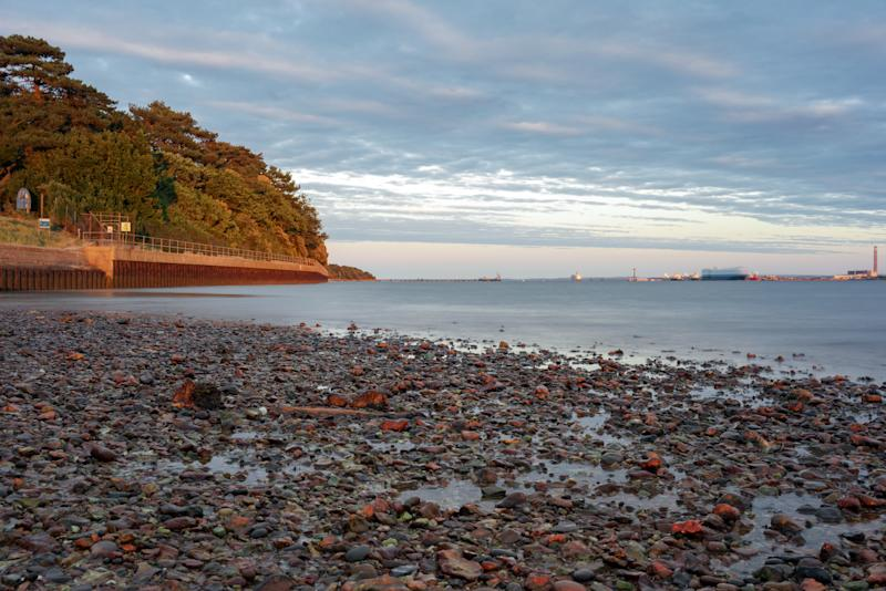 Southampton water at Royal Victoria Country park shoreline. The tide is going out.