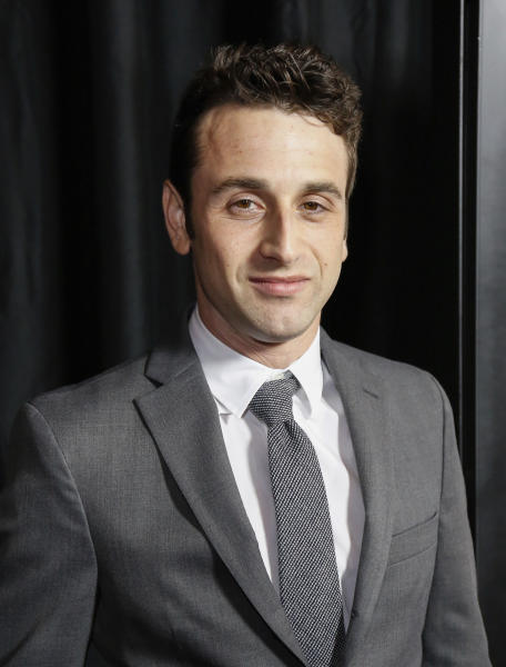 """FILE - This Jan. 14, 2017 file photo shows Justin Hurwitz at the 42nd Annual Los Angeles Film Critics Association Awards in Los Angeles. For """"La La Land"""" composer and songwriter Justin Hurwitz, it's been a long, laborious ride from dreaming up the musical """"La La Land"""" with his old college roommate Damien Chazelle over six years ago to becoming the toast of awards season. He has won a handful of critics' awards, a BAFTA and two Golden Globe Awards for score and original song. He is nominated for three Oscars, one for best score and two for best song. (Photo by Willy Sanjuan/Invision/AP, File)"""