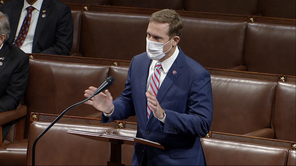 In this image from video, Rep. Ted Budd, R-N.C., speaks speaks on the House floor early Jan. 7, 2021. A dirty word for many Republicans is making the rounds on Capitol Hill -- earmarks. For nearly a decade, both chambers of Congress have abided by a ban on earmarks, or spending requested by a lawmaker to fund a specific project or institution back home. But Democrats are moving to bring back the practice, leaving the GOP lawmakers divided over how to respond. (House Television via AP)