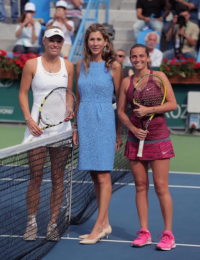 Caroline Wozniacki of Denmark, left, and Roberta Vinci of Italy, right, pose with former tennis star Monica Seles during their tennis final match at the Istanbul Cup in Istanbul, Turkey, Sunday, July 20, 2014. Wozniacki overpowered second-seeded Vinci 6-1, 6-1 Sunday to win the Istanbul Cup final and clinch her first WTA title of the year.(AP Photo)