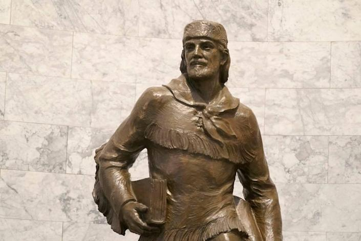 A statue of Marcus Whitman is displayed in the Legislative Building at the Capitol in Olympia, Wash., Wednesday, May 12, 2021. For generations, Whitman has been viewed as an iconic figure from early Pacific Northwest history, a venerated Protestant missionary who was among 13 people killed by the Cayuse tribe near modern-day Walla Walla, Washington, in 1847. But this past year has seen the continued reappraisal of Whitman, whose actions are now viewed by many as imperialistic and destructive, and the Washington Legislature voted to remove a similar statue of Whitman from Statuary Hall in Washington, D.C. (AP Photo/Ted S. Warren)