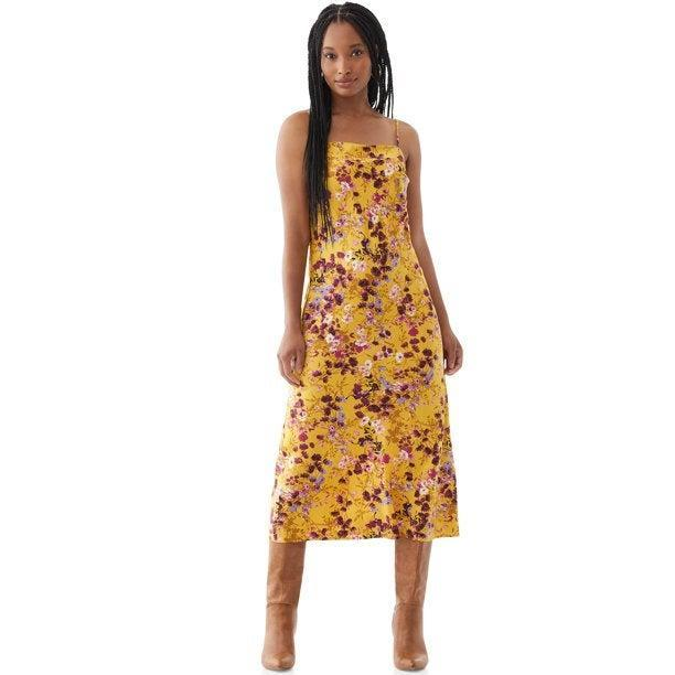 """<h2>Scoop Printed Midi Slip Dress</h2><br><strong><em>The Surprise<br></em></strong><br>Friends: don't sleep on Scoop. The in-house Walmart brand — which recently tapped designer <a href=""""https://www.refinery29.com/en-us/2021/03/10368406/brandon-maxwell-walmart-creative-director-free-assembly-scoop"""" rel=""""nofollow noopener"""" target=""""_blank"""" data-ylk=""""slk:Brandon Maxwell as a creative director"""" class=""""link rapid-noclick-resp"""">Brandon Maxwell as a creative director</a> — offers unexpectedly high-end style paired with good, old-fashioned rollback pricing.<br><br><strong>The Hype:</strong> 4.6 out of 5 stars; 7 reviews on Walmart.com<br><br><strong>What They're Saying:</strong> """"For $16, I cant believe how nice this dress is! I normally don't buy clothes at Walmart but I decided to take a chance for $16. Glad I did. It's 100% polyester but it feels like silk."""" — Elizabeth, Walmart.com reviewer<br><br><em>Shop <strong><a href=""""https://www.walmart.com/browse/scoop/scoop-shop-all/5438_3317124_5800740_2704792"""" rel=""""nofollow noopener"""" target=""""_blank"""" data-ylk=""""slk:Scoop"""" class=""""link rapid-noclick-resp"""">Scoop</a> </strong>at Walmart</em><br><br><strong>Scoop</strong> Printed Midi Slip Dress, $, available at <a href=""""https://go.skimresources.com/?id=30283X879131&url=https%3A%2F%2Fwww.walmart.com%2Fip%2FScoop-Women-s-Printed-Midi-Slip-Dress%2F580357900"""" rel=""""nofollow noopener"""" target=""""_blank"""" data-ylk=""""slk:Walmart"""" class=""""link rapid-noclick-resp"""">Walmart</a>"""