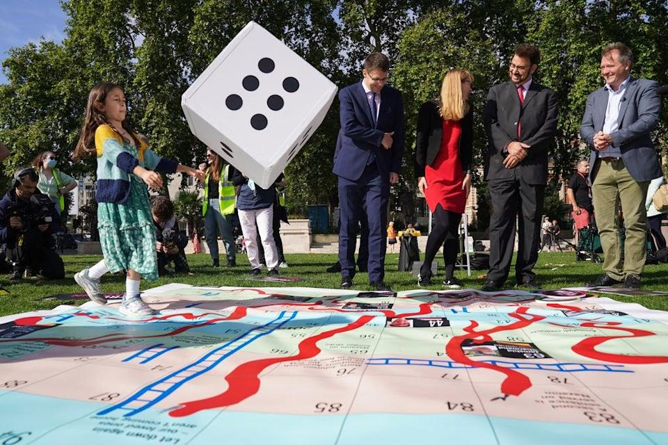 The giant snakes and ladders board in Parliament Square (Kirsty O'Connor/PA) (PA Wire)