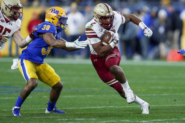 Boston College running back AJ Dillon (2) runs past Pittsburgh linebacker Cam Bright (38) during the first half of an NCAA college football game, Saturday, Nov. 30, 2019, in Pittsburgh. (AP Photo/Keith Srakocic)