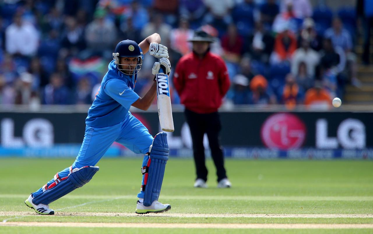 India's Rohit Sharma drives during the ICC Champions Trophy match against South Africa, at the SWALEC Stadium, Cardiff.