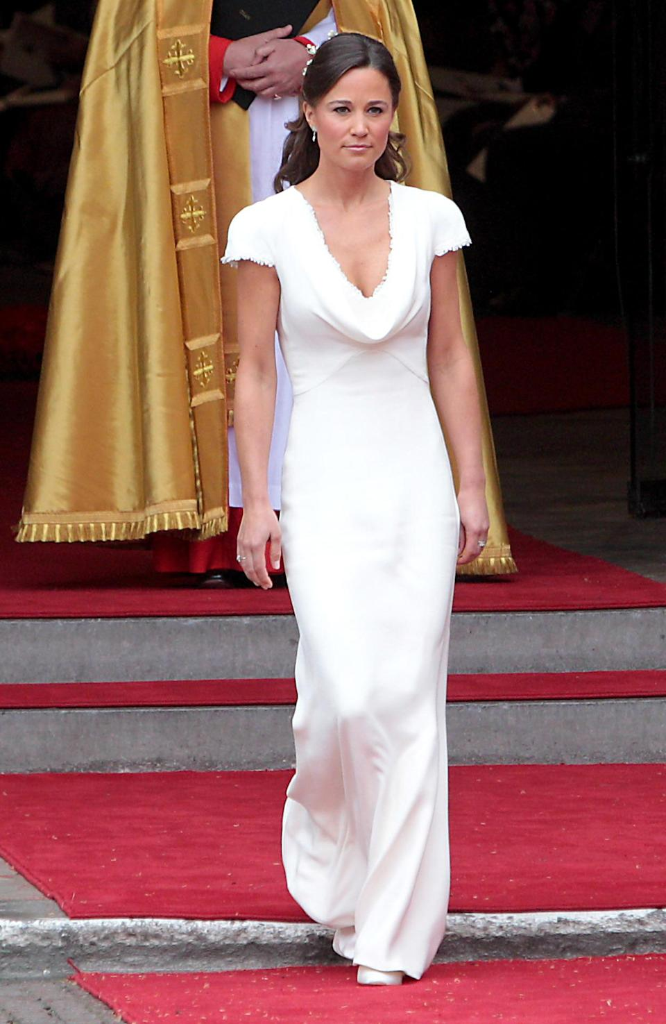 <p>Just like Kate, Pippa wore a custom made Alexander McQueen number for the wedding of the decade. The crisp, white dress featured a cowl neck design, cap sleeves and a fishtail skirt. <i>[Photo: Rex]</i> </p>
