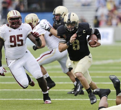 Army quarterback Trent Steelman (8) scores the game-winning touchdown past Boston College defensive lineman Dominic Appiah (95) during the second half of an NCAA college football game Saturday, Oct. 6, 2012, in West Point, N.Y. Army won, 34-31. (AP Photo/Mike Groll)