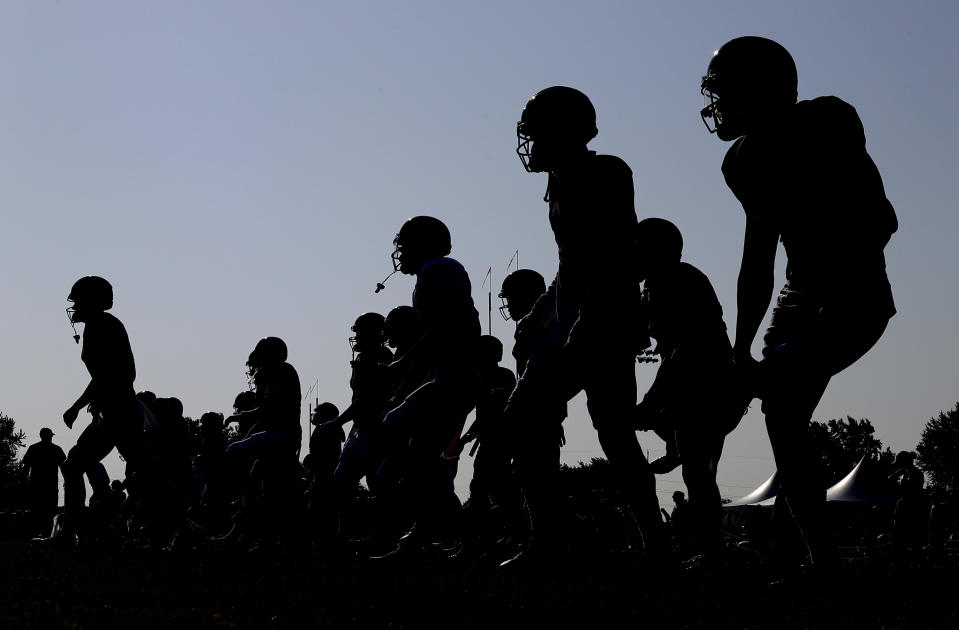 Chicago Bears players warm up during an NFL football training camp in Bourbonnais, Ill., Sunday, July 28, 2019. (AP Photo/Nam Y. Huh)