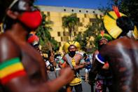 Indigenous Brazilians from different ethnic groups take part in a protest to defend demarcation of indigenous lands, in Brasilia
