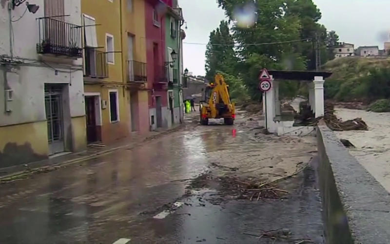 In this image made from video provided by Atlas, the flooded streets are seen in Ontiyente, Spain, Thursday, Sept. 12 2019.  A large area of southeast Spain was battered Thursday by what was forecast to be its heaviest rainfall in more than a century, with the storms wreaking widespread destruction and killing at least two people. (Atlas via AP)
