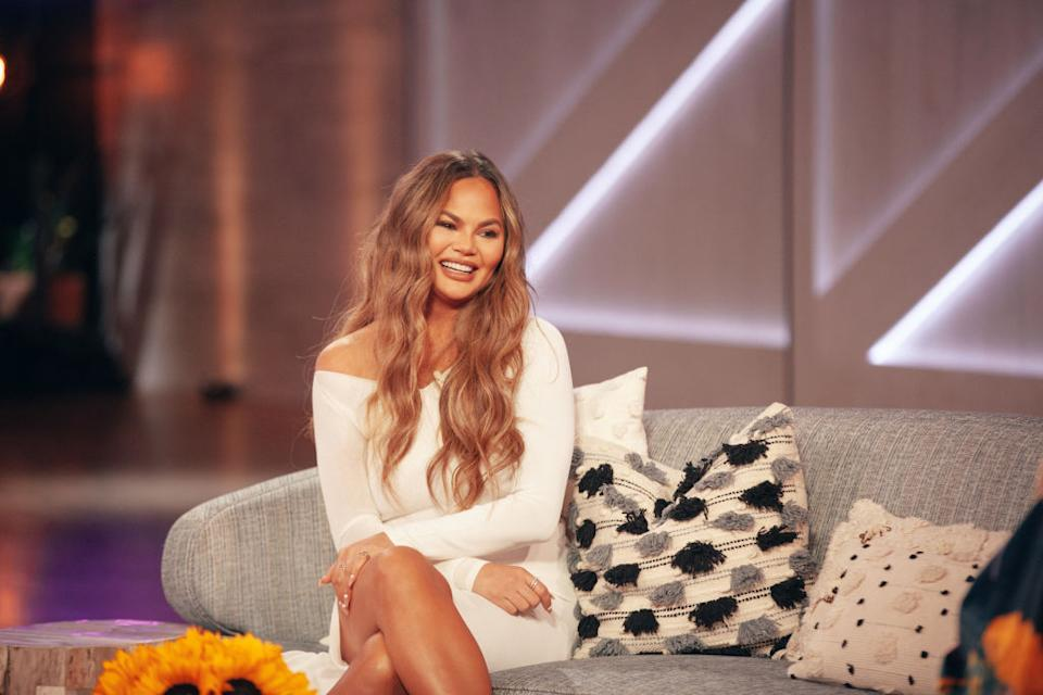 Chrissy Teigen is urging people to open up about their fertility struggles, pictured on The Kelly Clarkson Show, March 2021 (Photo by: Weiss Eubanks/NBCUniversal/NBCU Photo Bank via Getty Images)