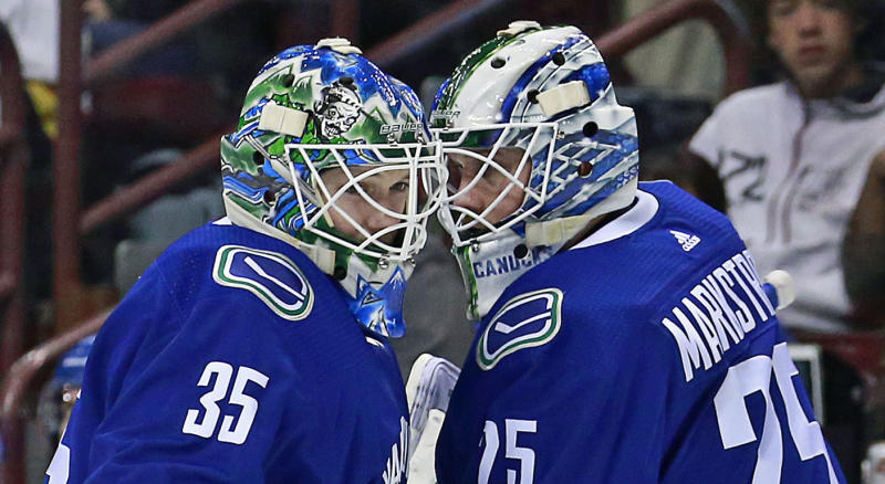 VANCOUVER, BC - MARCH 9: Thatcher Demko #35 of the Vancouver Canucks is switch out with teammate Jacob Markstrom #25 during their NHL game against the Vegas Golden Knights at Rogers Arena March 9, 2019 in Vancouver, British Columbia, Canada. (Photo by Jeff Vinnick/NHLI via Getty Images)