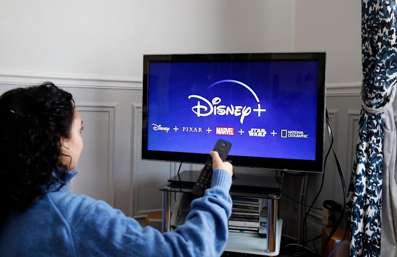 PARIS, FRANCE - NOVEMBER 20: In this photo illustration, the Disney + logo is displayed on the screen of a TV on November 20, 2019 in Paris, France. The Walt Disney Company launched its Disney + Streaming Service (Svod) in the United States on November 12, 2019, but barely a week after its release, thousands of pirated client accounts were sold on the black market. (Photo by Chesnot/Getty Images)
