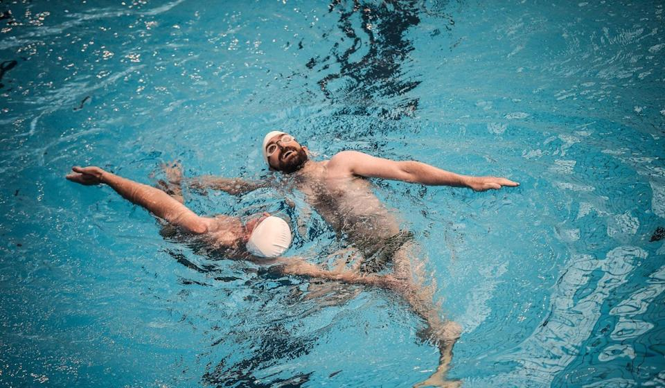 Participants compete during the synchronised swimming contest at the 2018 Gay Games in Paris. Photo: AFP