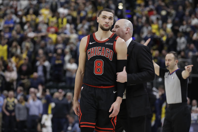 Chicago Bulls coach Jim Boylen talks with Zach LaVine during overtime of their 115-106 loss to the Indiana Pacers on Wednesday, Jan. 29, 2020, in Indianapolis.