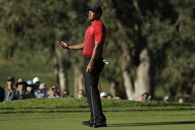 "<a class=""link rapid-noclick-resp"" href=""/pga/players/147/"" data-ylk=""slk:Tiger Woods"">Tiger Woods</a> reacted accordingly after a fan yelled during his backswing. (AP)"