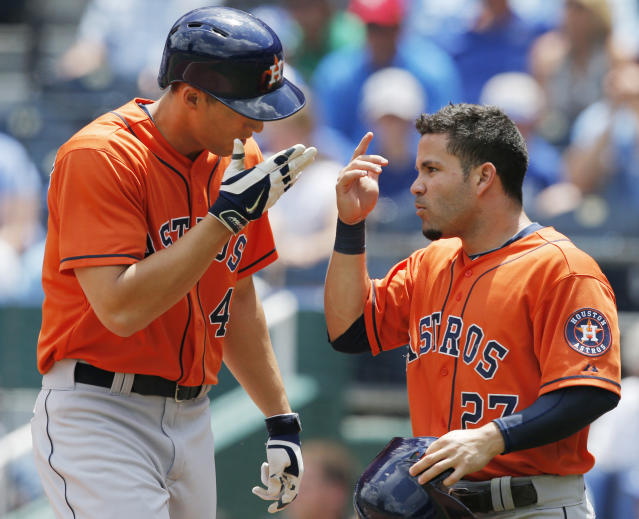Houston Astros' George Springer (4), left, celebrates his two-run home run with teammate Jose Altuve (27) during the first inning of a baseball game at Kauffman Stadium in Kansas City, Mo., Wednesday, May 28, 2014. (AP Photo/Orlin Wagner)