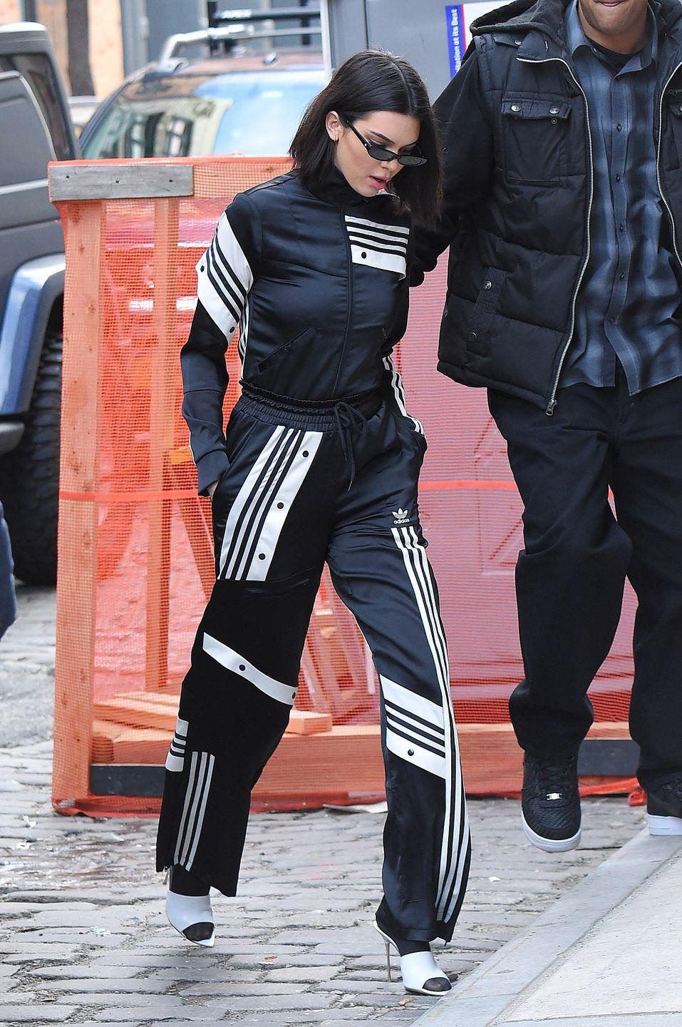 <p>The model wore an Adidas Originals black tracksuit while out in New York City, February 2018 </p>